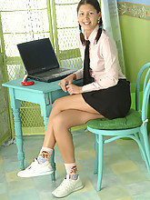 Nice little schoolgirl strips from her uniform and spreads